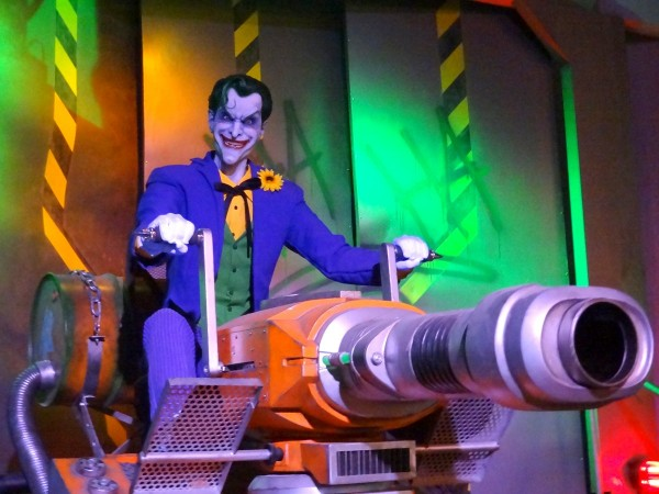 Fighting the Joker on Justice League: Battle for Metropolis, the interactive dark rides at multiple Six Flags parks.